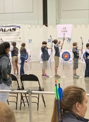 Local shooters perform during Saturday's Archery in Louisiana Schools competition Saturday at the Shreveport Convention Center.
