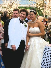 Graham P. Thompson and Carolyn P. Murphy at their wedding reception. When the evening was over at 10 p.m., the two left the reception and road down the street on a tandem bike, as revelers tossed bird seed.