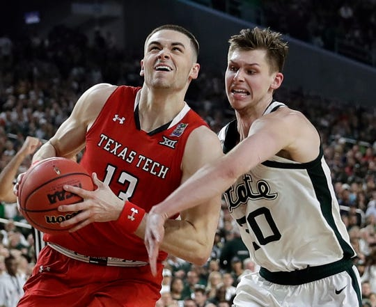 Texas Tech guard Matt Mooney drives to the basket past Michigan State guard Matt McQuaid, right, during the second half in the semifinals of the Final Four NCAA college basketball tournament, Saturday, April 6, 2019, in Minneapolis. (AP Photo/David J. Phillip)