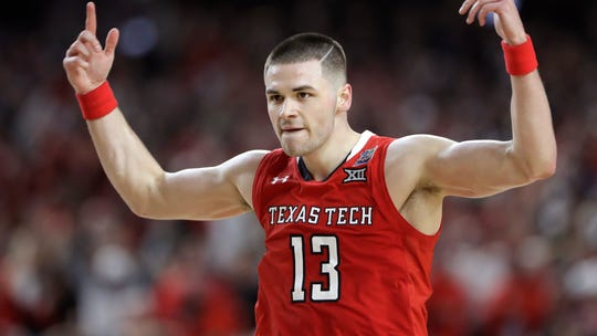 Texas Tech guard Matt Mooney celebrates after making a three-point basket during the second half against Michigan State in the semifinals of the Final Four NCAA college basketball tournament, Saturday, April 6, 2019, in Minneapolis. (AP Photo/Jeff Roberson)