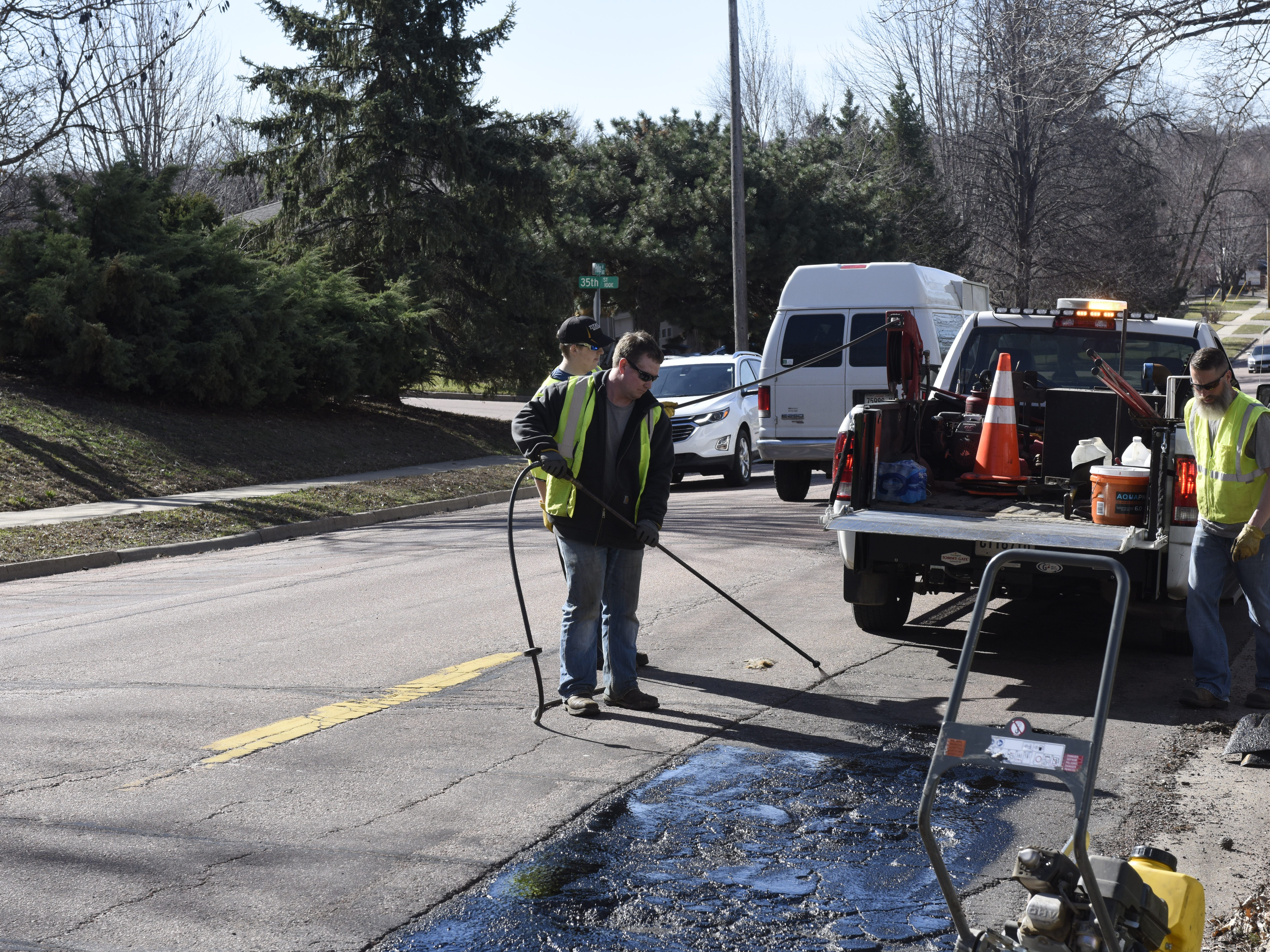Reece Cunningham, Mike O'Kane and Chad Sundvold repair a road on April 8.