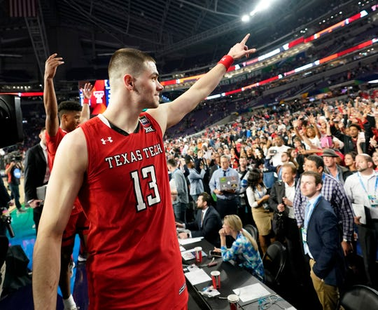 Texas Tech guard Matt Mooney reacts to fans after a semifinal round game against Michigan State in the Final Four NCAA college basketball tournament, Saturday, April 6, 2019, in Minneapolis. (AP Photo/David J. Phillip)