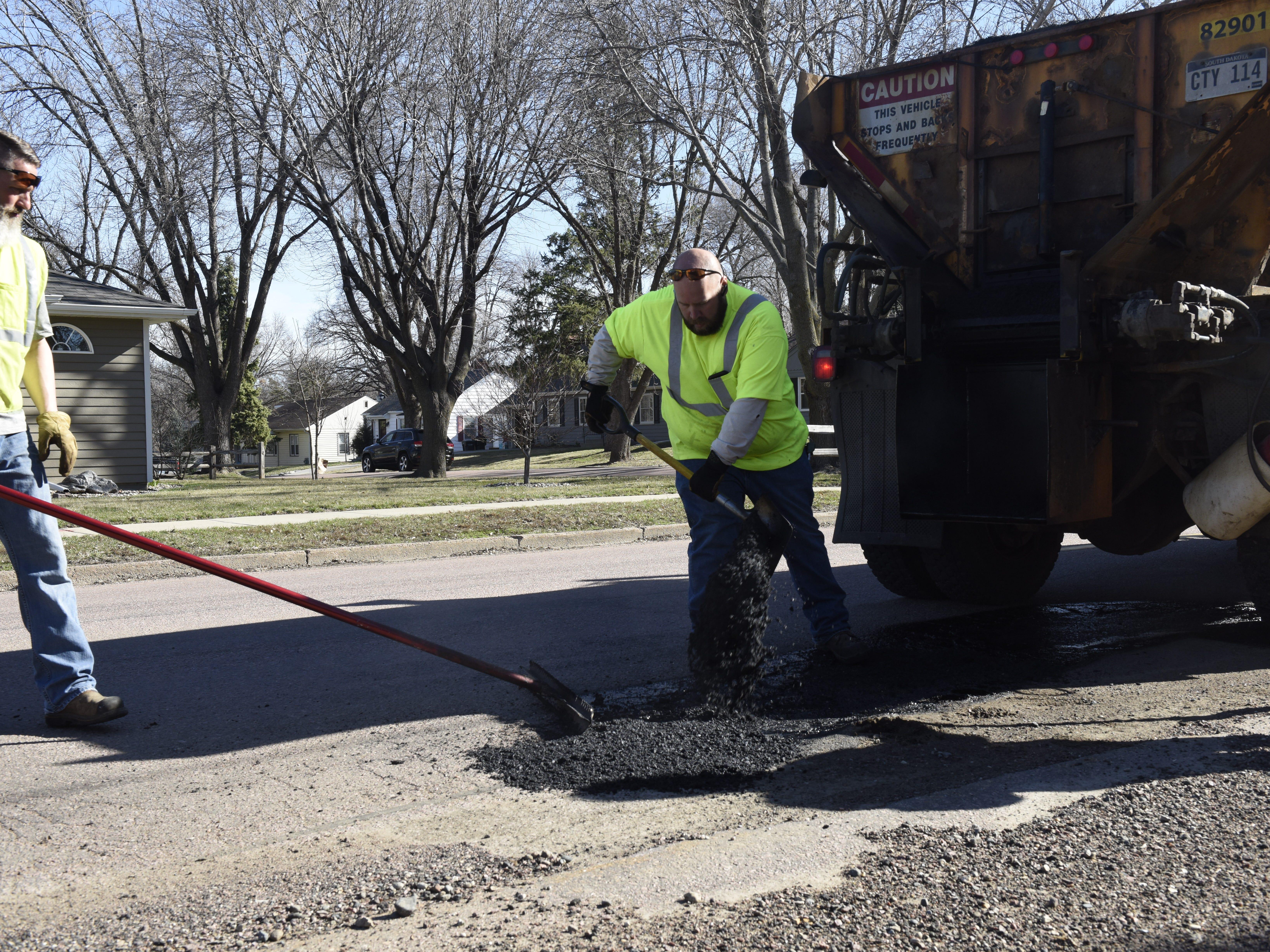Chad Sundvold and Erik Harrington repair a road on April 8.