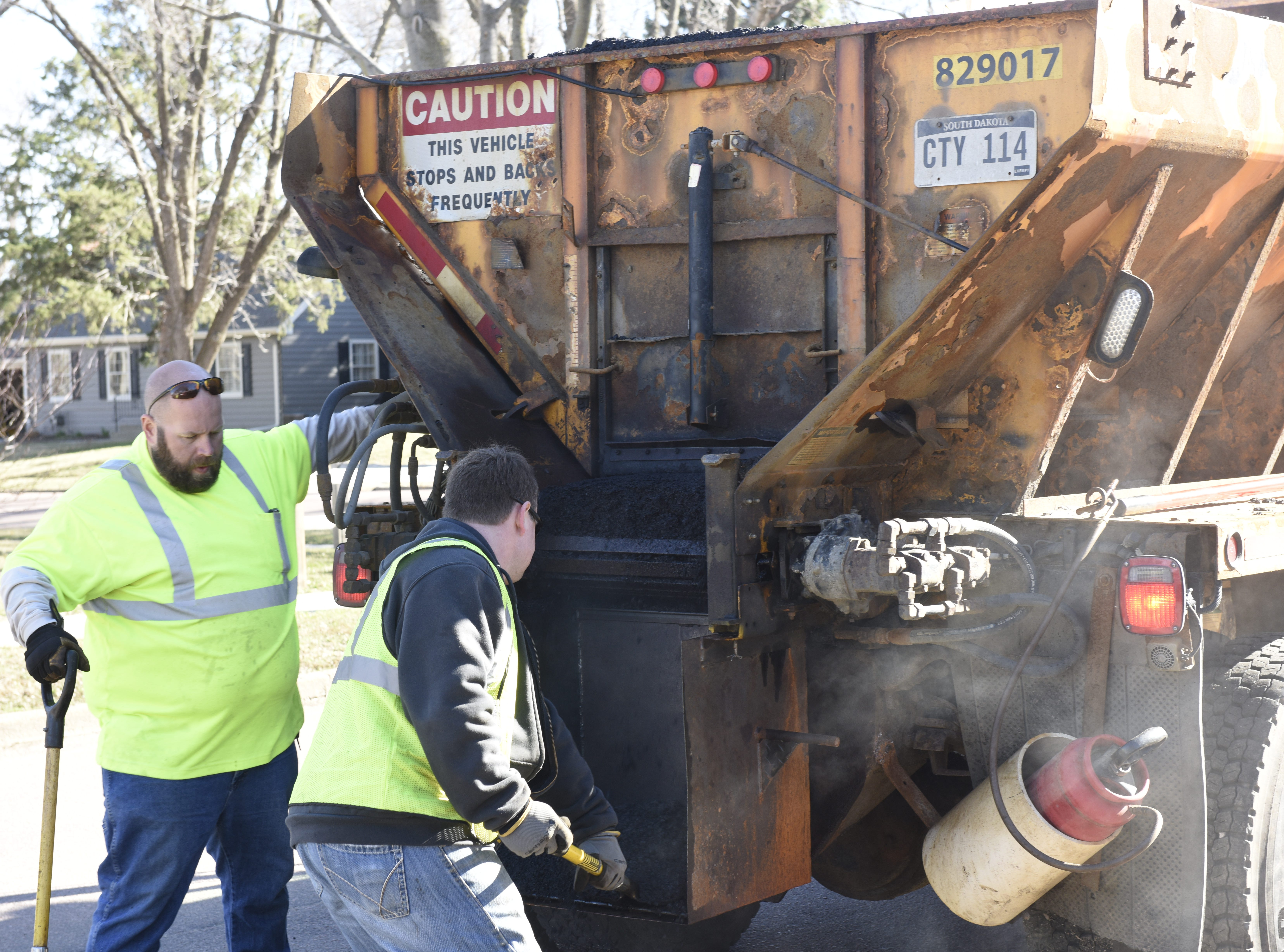 Erik Harrington and Mike O'Kane repair a road on April 8.
