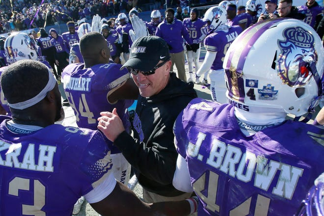 James Madison Dukes head coach Mike Houston celebrates winning the FCS n national championship in 2017 with defensive lineman Andrew Ankrah (93) . Ankrah, who graduated from JMU in 2017, signed with the Washington Redskins Monday.