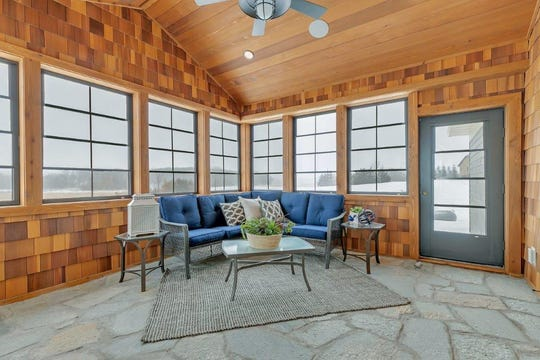 The screened sun porch features vaulted ceilings.