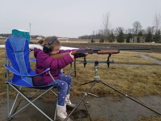 A youth shooter lines up a target downrange. Patterning shotguns is an important part of turkey hunting preparation.
