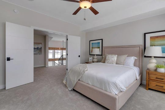The master bedroom sits on the upper level of the home via the open air staircase and through a set of French doors.
