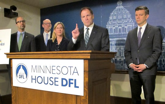Minnesota House Tax Committee Chairman Paul Marquart, second from right, presents the House Democratic tax bill at a news conference at the state Capitol on Monday, April 8, 2019, in St. Paul, Minn. Joining MarquartI for the presentation from left are, Reps. Dave Pinto and Jim Davnie, House Speaker Melissa Hortman, Marquart, and House Majority Leader Ryan Winkler. (AP Photo/Steve Karnowski)