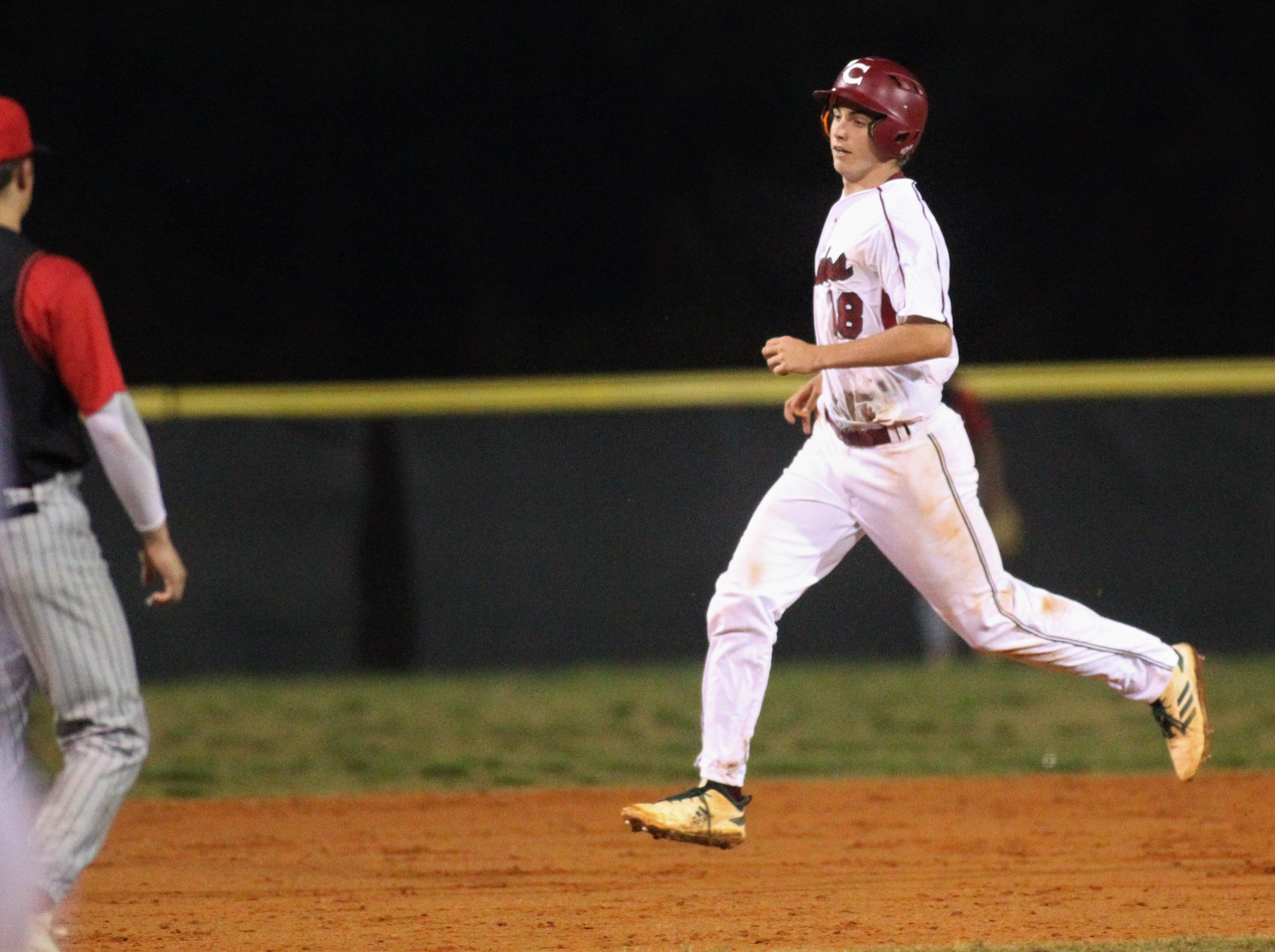 Chiles senior William Kilduff trots around the bases after a solo home run as Chiles won an 11-6 home game against Leon on Friday, April 5, 2019, to force a season split. The Lions won 3-0 earlier in the week.
