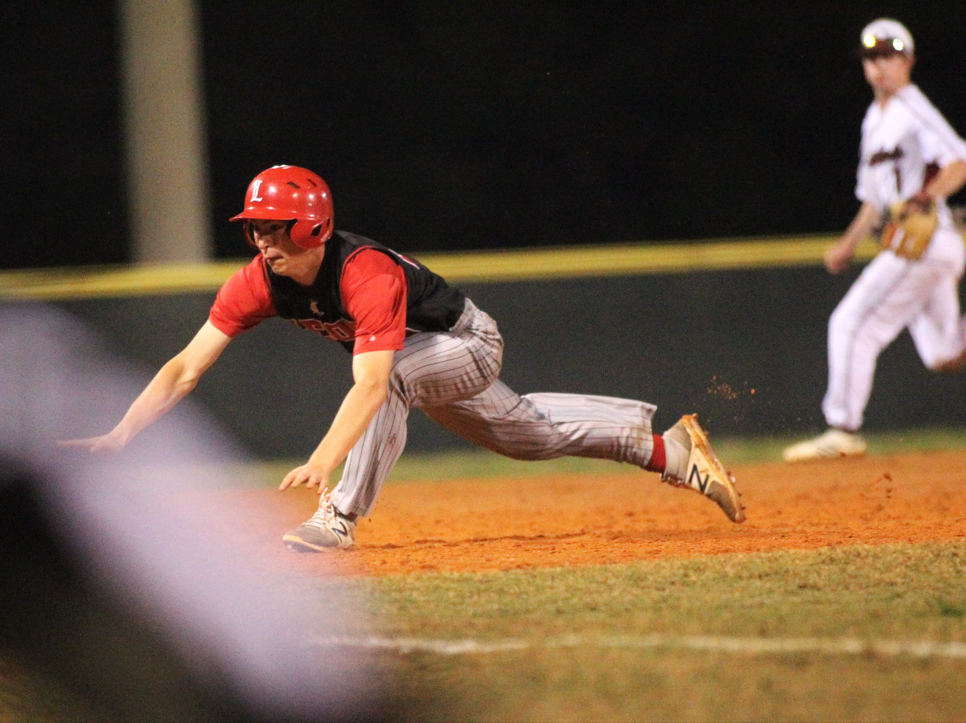 Leon junior Nick Flynt slides into third base on a passed ball as Chiles won an 11-6 home game against Leon on Friday, April 5, 2019, to force a season split. The Lions won 3-0 earlier in the week.