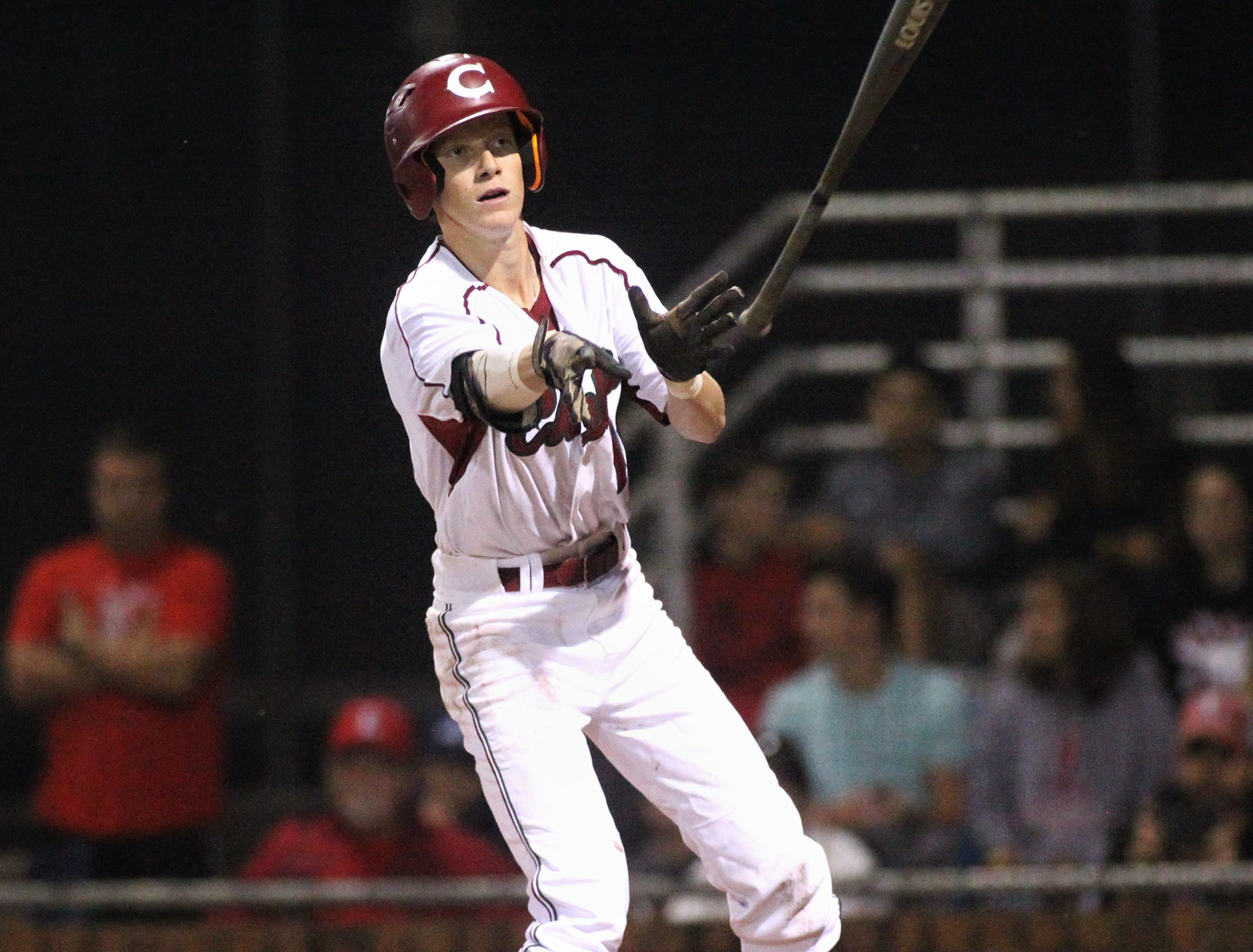 Chiles senior Sam Rudd tosses his bat after a walk as Chiles won an 11-6 home game against Leon on Friday, April 5, 2019, to force a season split. The Lions won 3-0 earlier in the week.