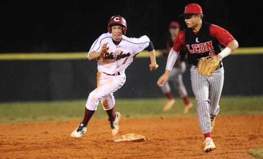 Chiles senior Zach Holcomb races around second to third as Chiles won an 11-6 home game against Leon on Friday, April 5, 2019, to force a season split. The Lions won 3-0 earlier in the week.