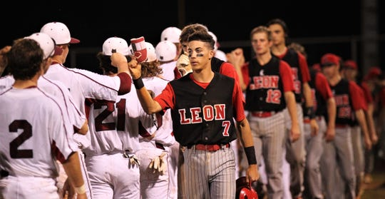 Leon senior True Fontenot leads the postgame handshake line as Chiles won an 11-6 home game against Leon on Friday, April 5, 2019, to force a season split. The Lions won 3-0 earlier in the week.
