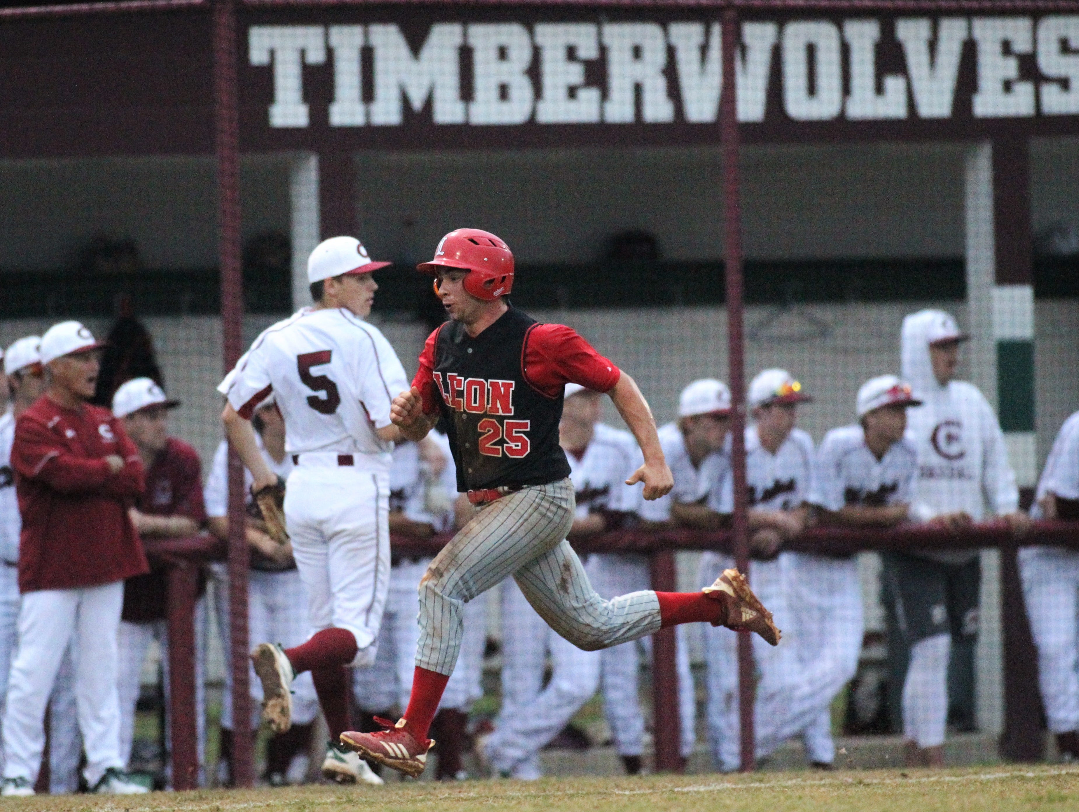 Leon senior Tyler Borges races home to score a run as Chiles won an 11-6 home game against Leon on Friday, April 5, 2019, to force a season split. The Lions won 3-0 earlier in the week.