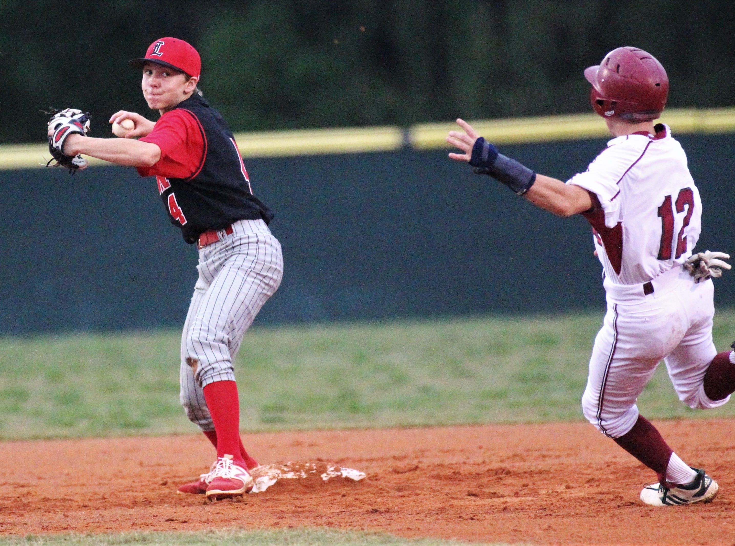 Leon second baseman Andrew Penney turns a double play as Chiles freshman Jaxson West slides in as Chiles won an 11-6 home game against Leon on Friday, April 5, 2019, to force a season split. The Lions won 3-0 earlier in the week.
