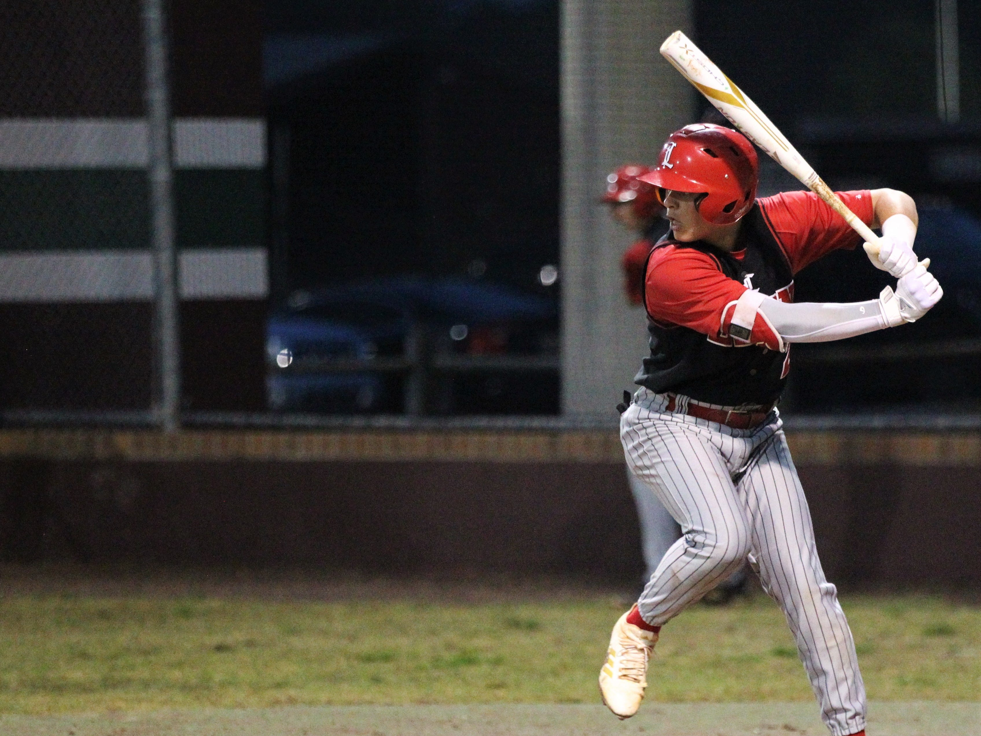 Leon junior Paxton Tomaini bats as Chiles won an 11-6 home game against Leon on Friday, April 5, 2019, to force a season split. The Lions won 3-0 earlier in the week.
