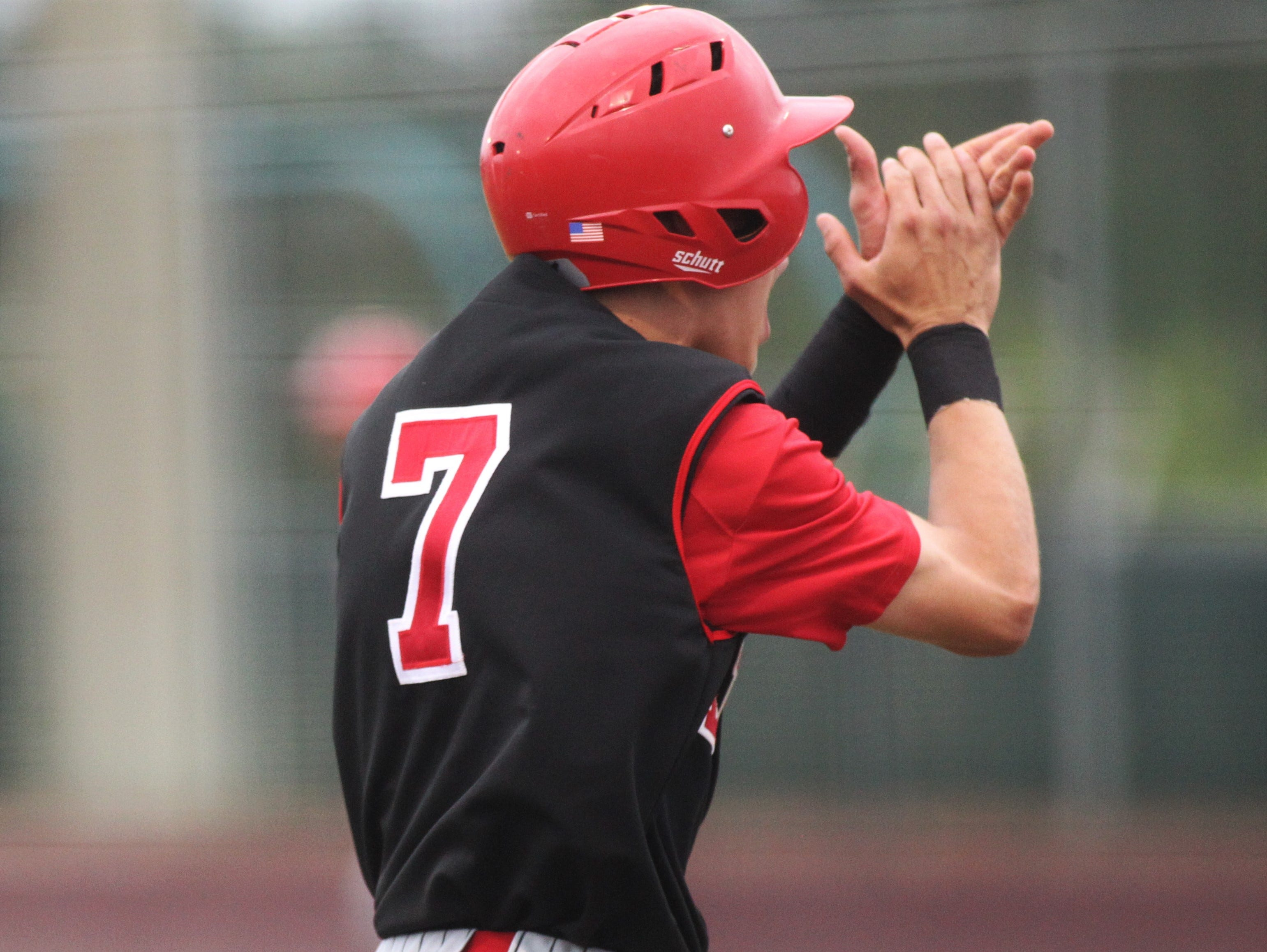 Leon senior True Fontenot claps while scoring a run, but Chiles won an 11-6 home game against Leon on Friday, April 5, 2019, to force a season split. The Lions won 3-0 earlier in the week.