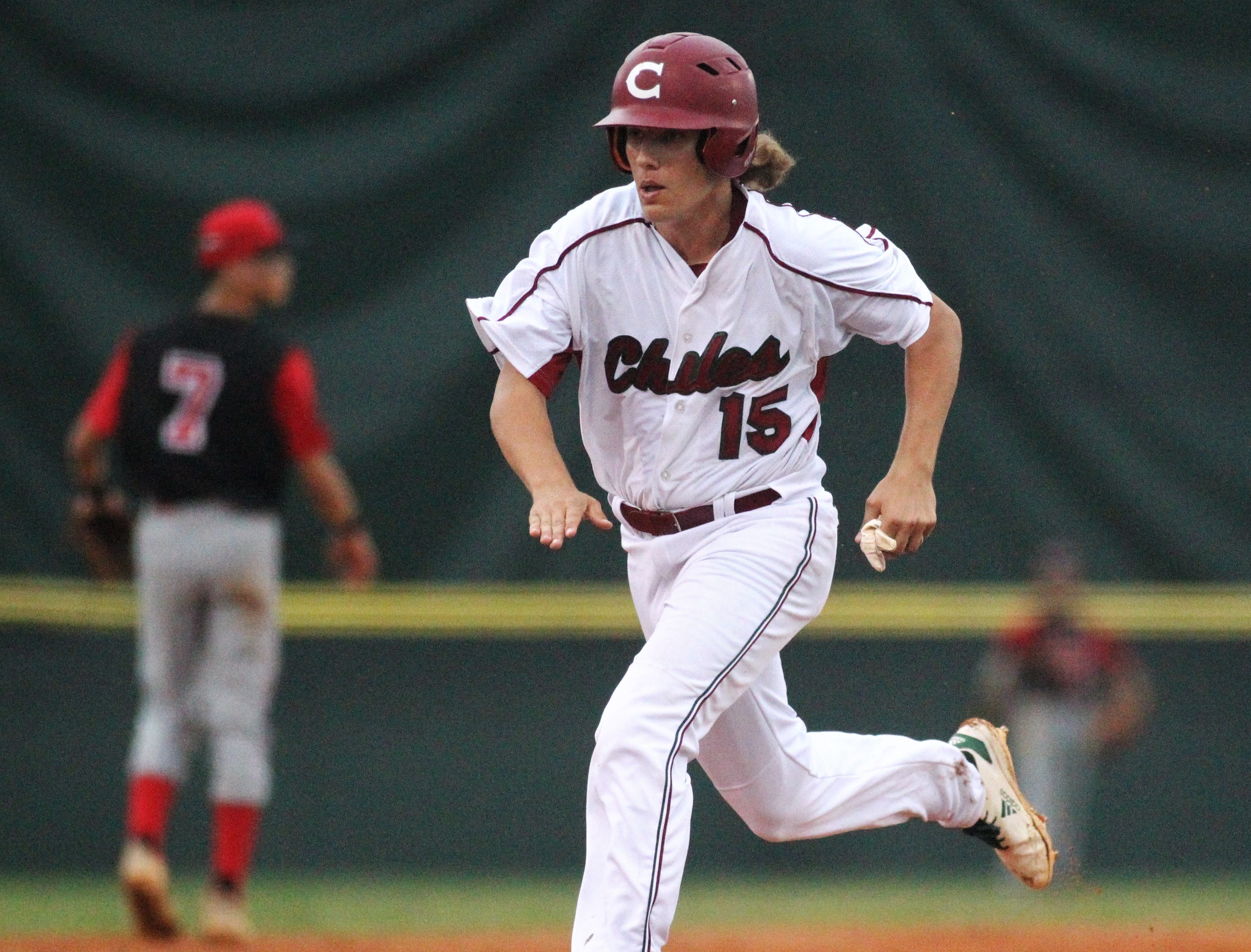 Chiles sophomore Tyler Gerteisen heads towards third base as Chiles won an 11-6 home game against Leon on Friday, April 5, 2019, to force a season split. The Lions won 3-0 earlier in the week.