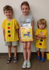 Story Time patrons in their home-made Pete the Cat T-shirts: Caleb Carter, Isabelle Smith and Jacob Carter.
