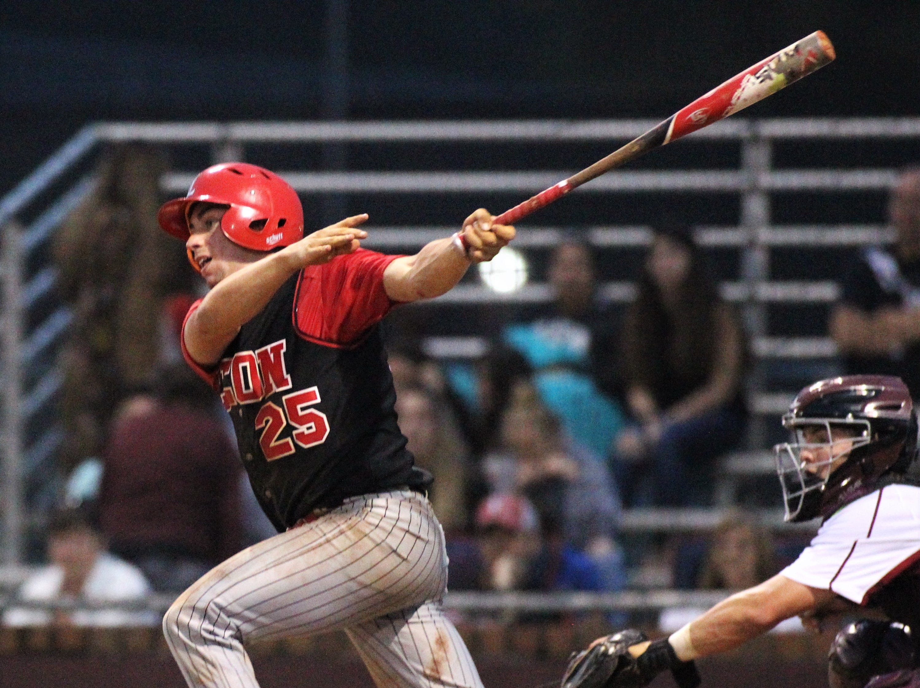 Leon senior Tyler Borges watches a hit as Chiles won an 11-6 home game against Leon on Friday, April 5, 2019, to force a season split. The Lions won 3-0 earlier in the week.