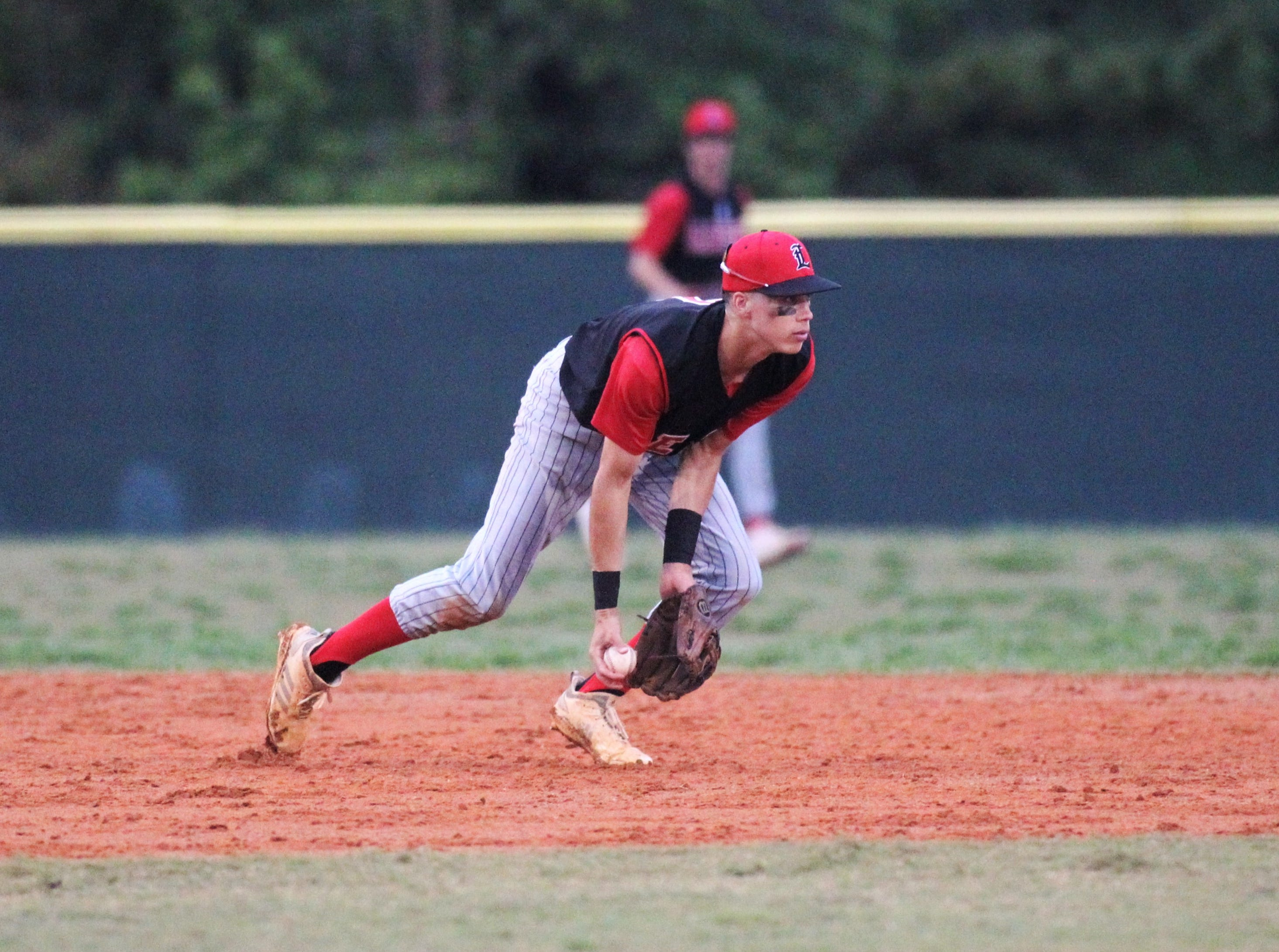 Leon shortstop True Fontenot flips to second to start a double play as Chiles won an 11-6 home game against Leon on Friday, April 5, 2019, to force a season split. The Lions won 3-0 earlier in the week.