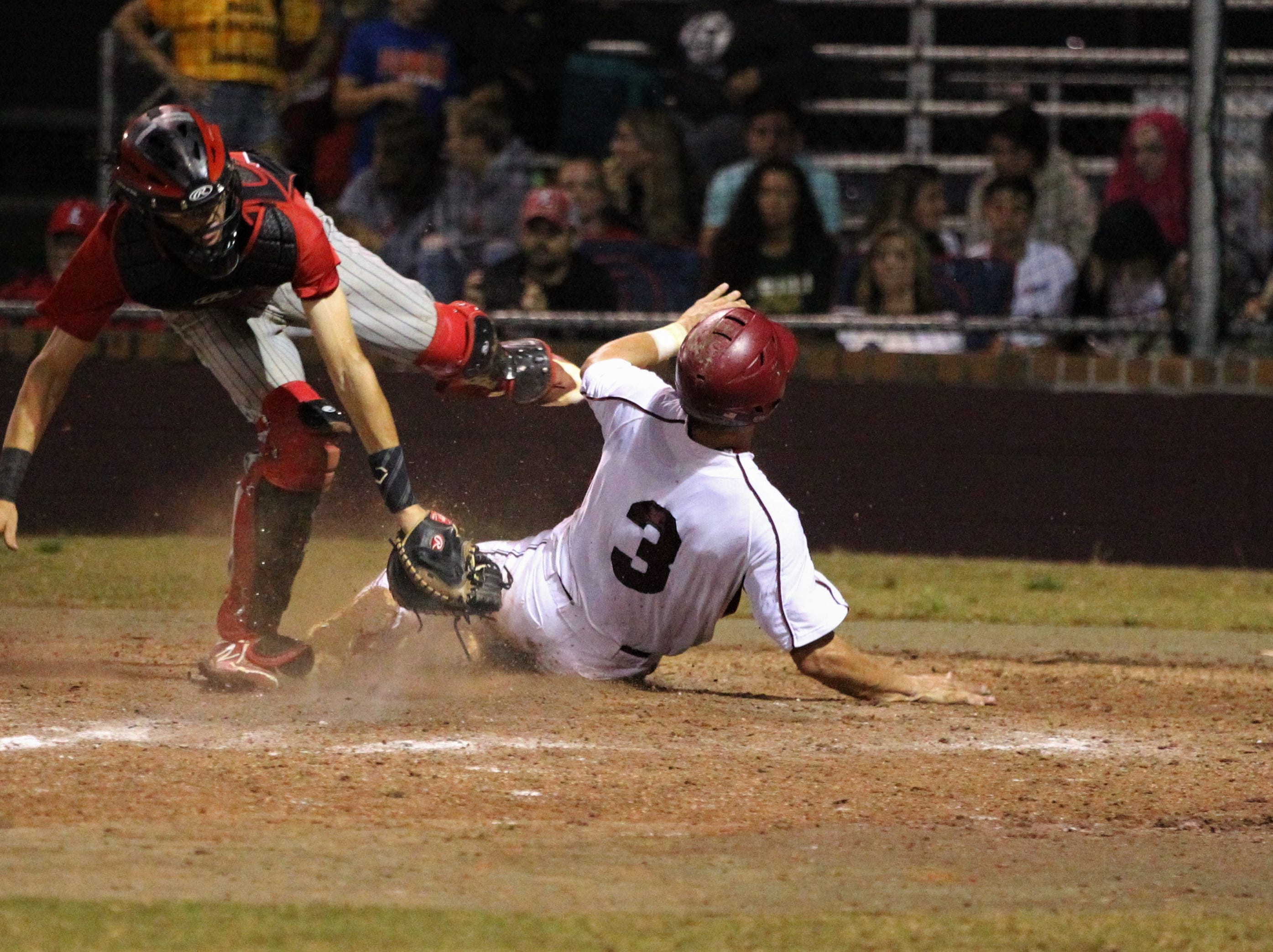 Chiles junior Garrett Green collides with Leon catcher Nick Flynt on a play at the plate but safely touches home as Chiles won an 11-6 home game against Leon on Friday, April 5, 2019, to force a season split. The Lions won 3-0 earlier in the week.