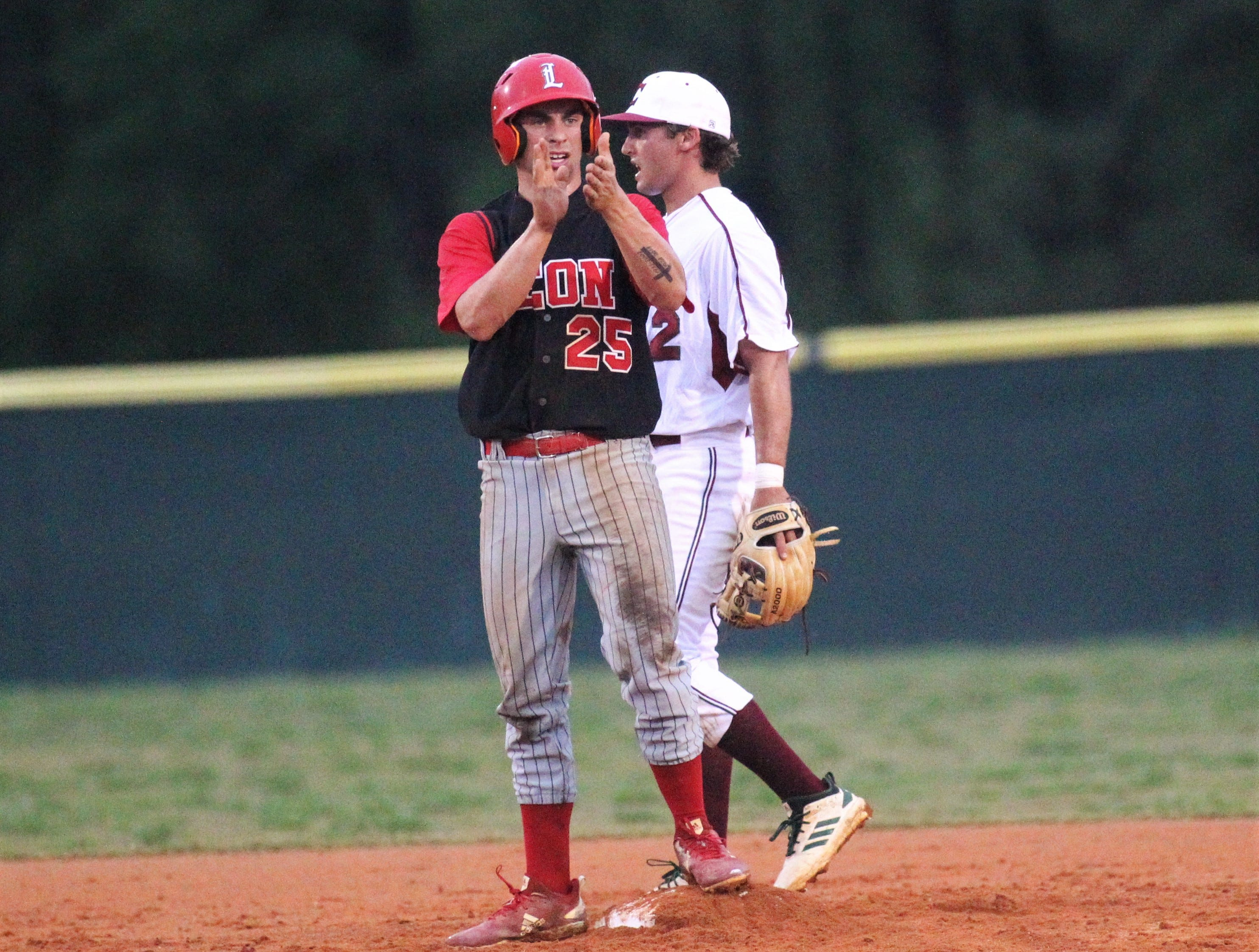 Leon senior Tyler Borges claps for a teammate's hit as Chiles won an 11-6 home game against Leon on Friday, April 5, 2019, to force a season split. The Lions won 3-0 earlier in the week.