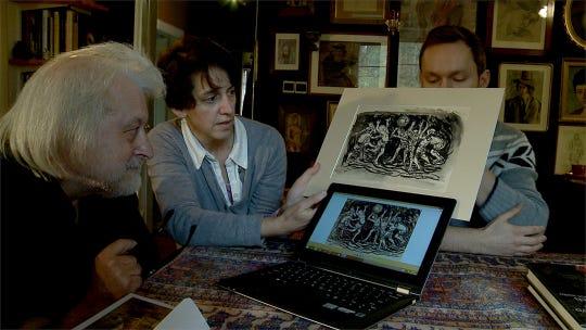 Elizabeth Rynecki and Edward Napiórkowski, an art collector, examine the Rynecki painting in his collection.