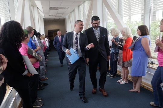 Sen. Manny Diaz, R-Miami-Dade, walks through as protestors with Planned Parenthood and Floridians for Reproductive Freedom before a Senate Health Policy Committee meeting where Senate Bill 1774 would be discussed in the Knott Building at the Capitol Monday, April 8, 2019. The bill would require parental or guardian consent for a minor to receive an abortion by a physician in Florida.