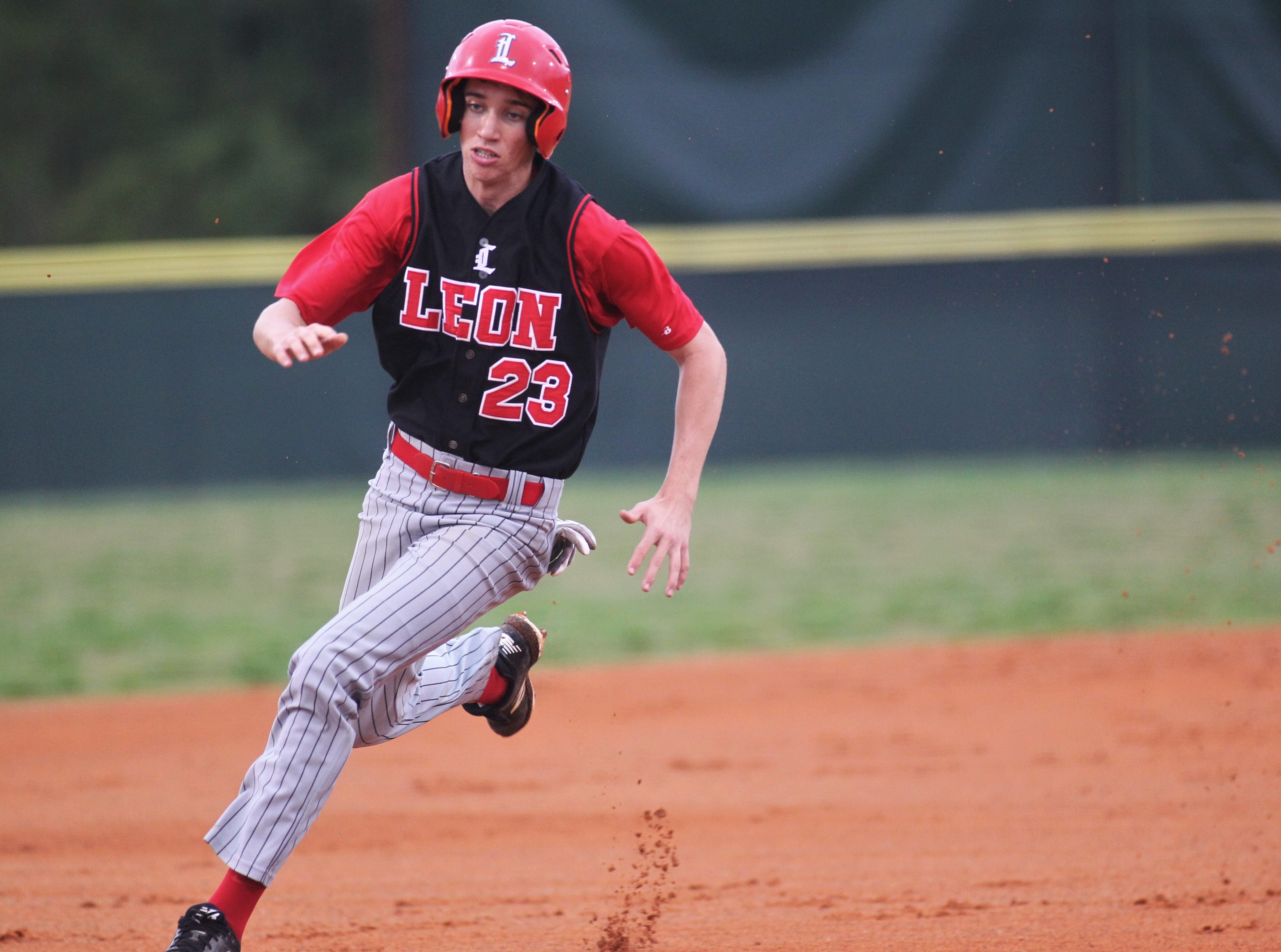 Leon junior Matt Williams races to third base as Chiles won an 11-6 home game against Leon on Friday, April 5, 2019, to force a season split. The Lions won 3-0 earlier in the week.