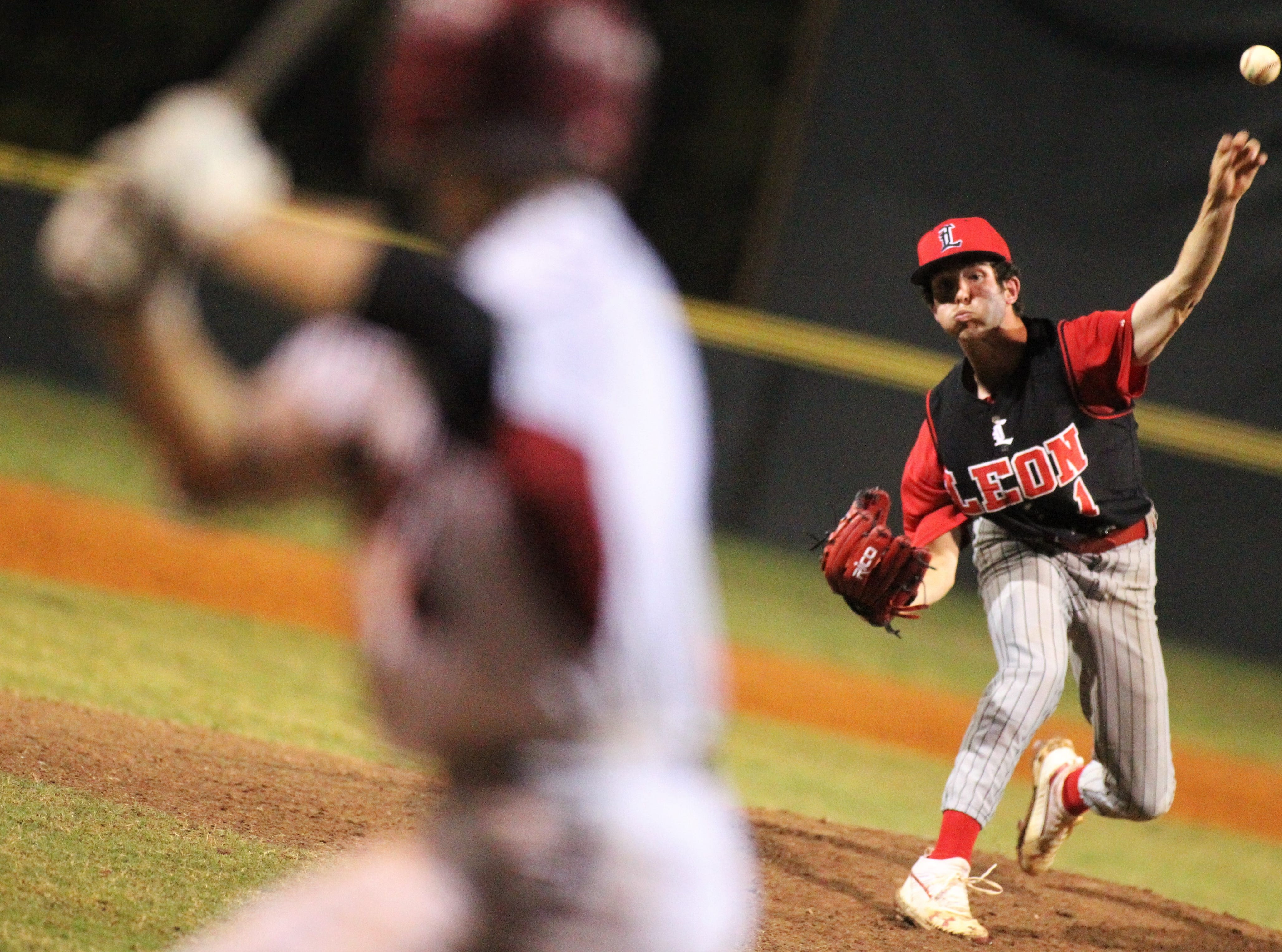 Leon junior Garrett Green pitches in relief as Chiles won an 11-6 home game against Leon on Friday, April 5, 2019, to force a season split. The Lions won 3-0 earlier in the week.