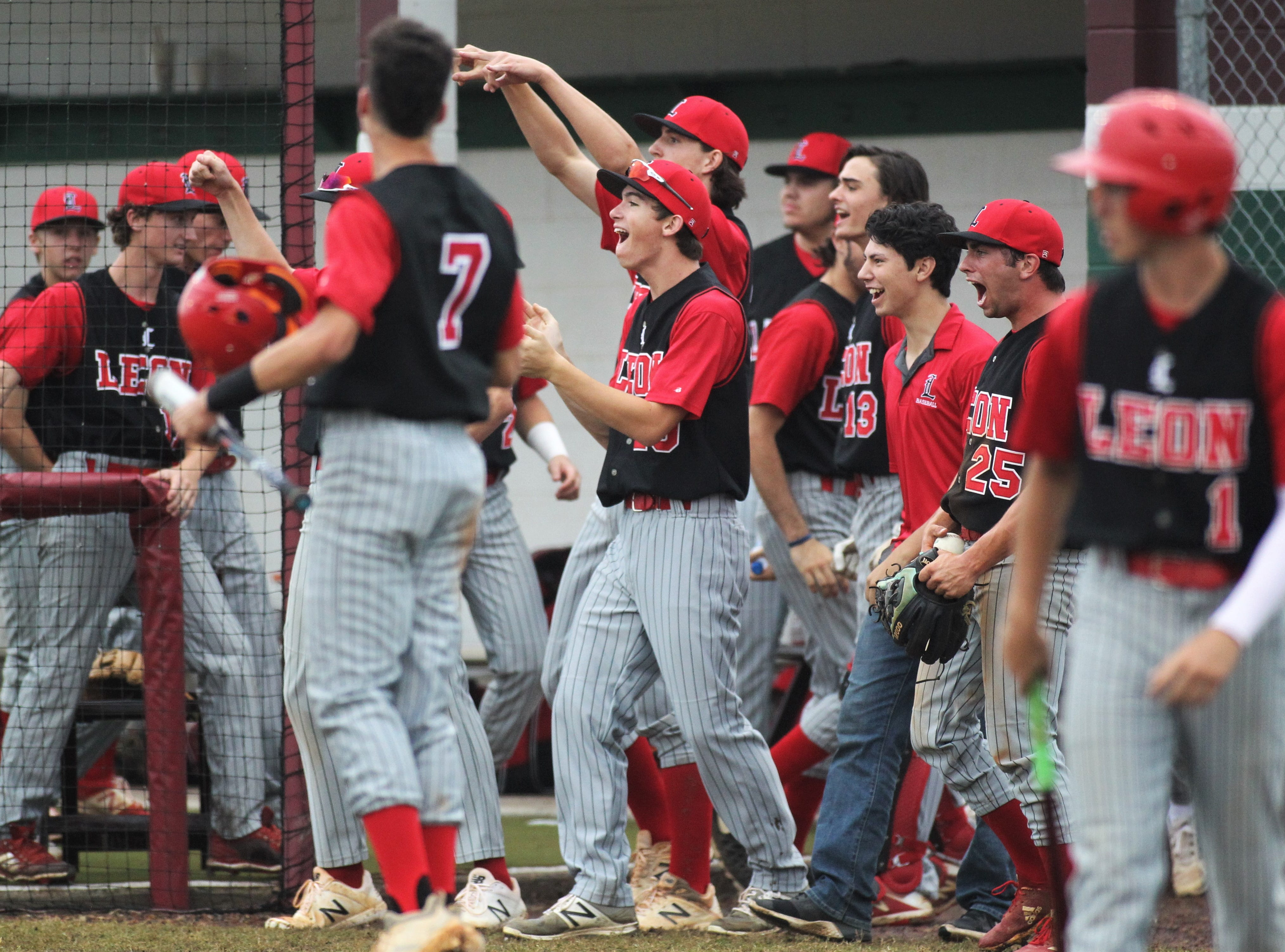 Leon's baseball team erupts after an RBI hit, but Chiles won an 11-6 home game against Leon on Friday, April 5, 2019, to force a season split. The Lions won 3-0 earlier in the week.