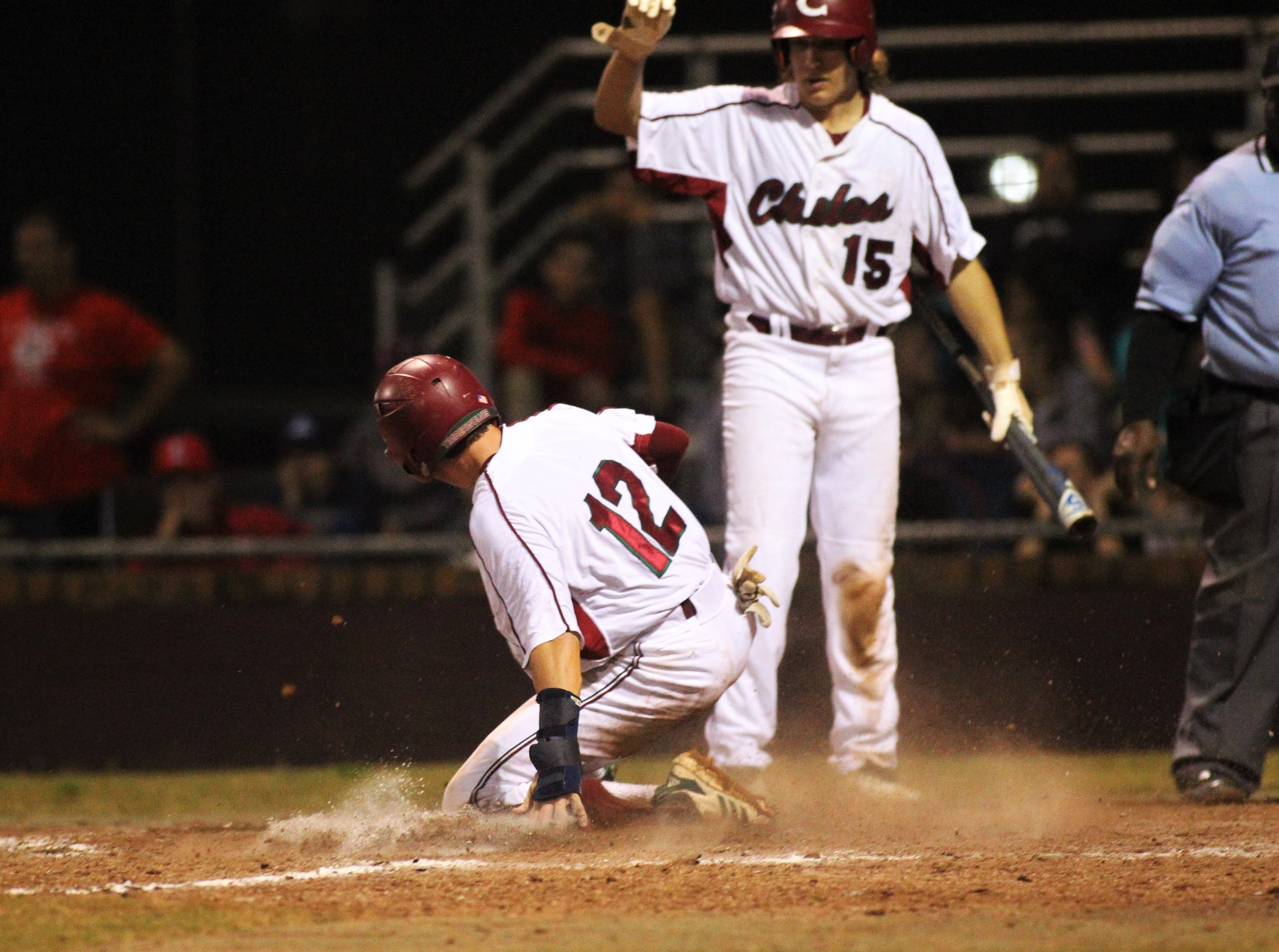 Chiles freshman Jaxson West slides in safely at home after a wild pitch as Chiles won an 11-6 home game against Leon on Friday, April 5, 2019, to force a season split. The Lions won 3-0 earlier in the week.
