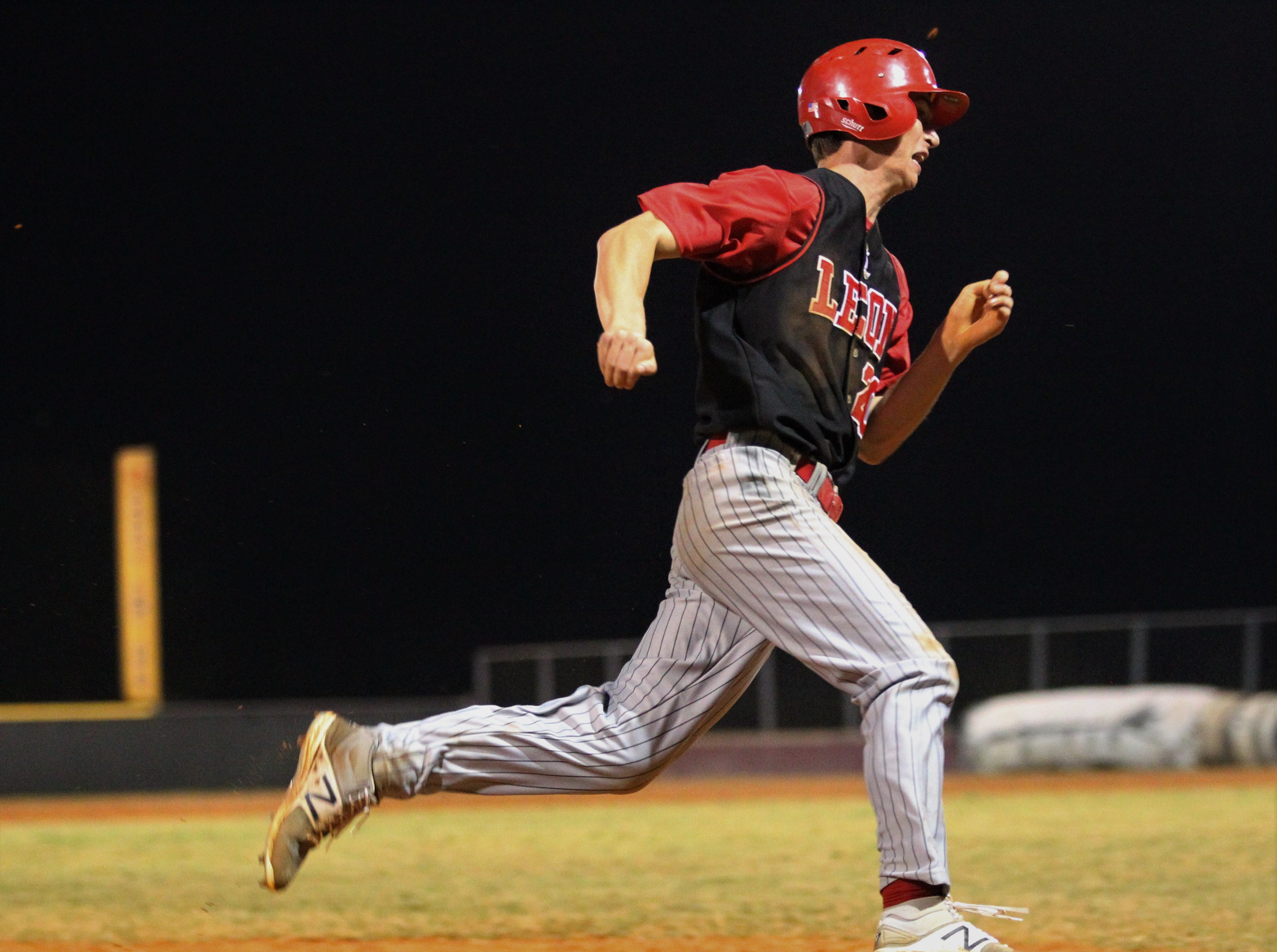Leon senior Drew Behenna races around third on the game's final out as Chiles won an 11-6 home game against Leon on Friday, April 5, 2019, to force a season split. The Lions won 3-0 earlier in the week.