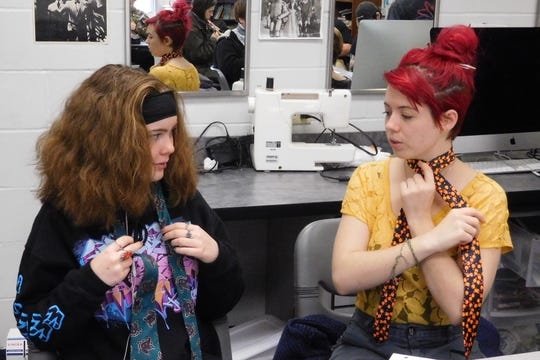 Izzy Cobelski, right, helps a classmate with a costuming lesson. Izzy's experience in theater has been a confidence builder.