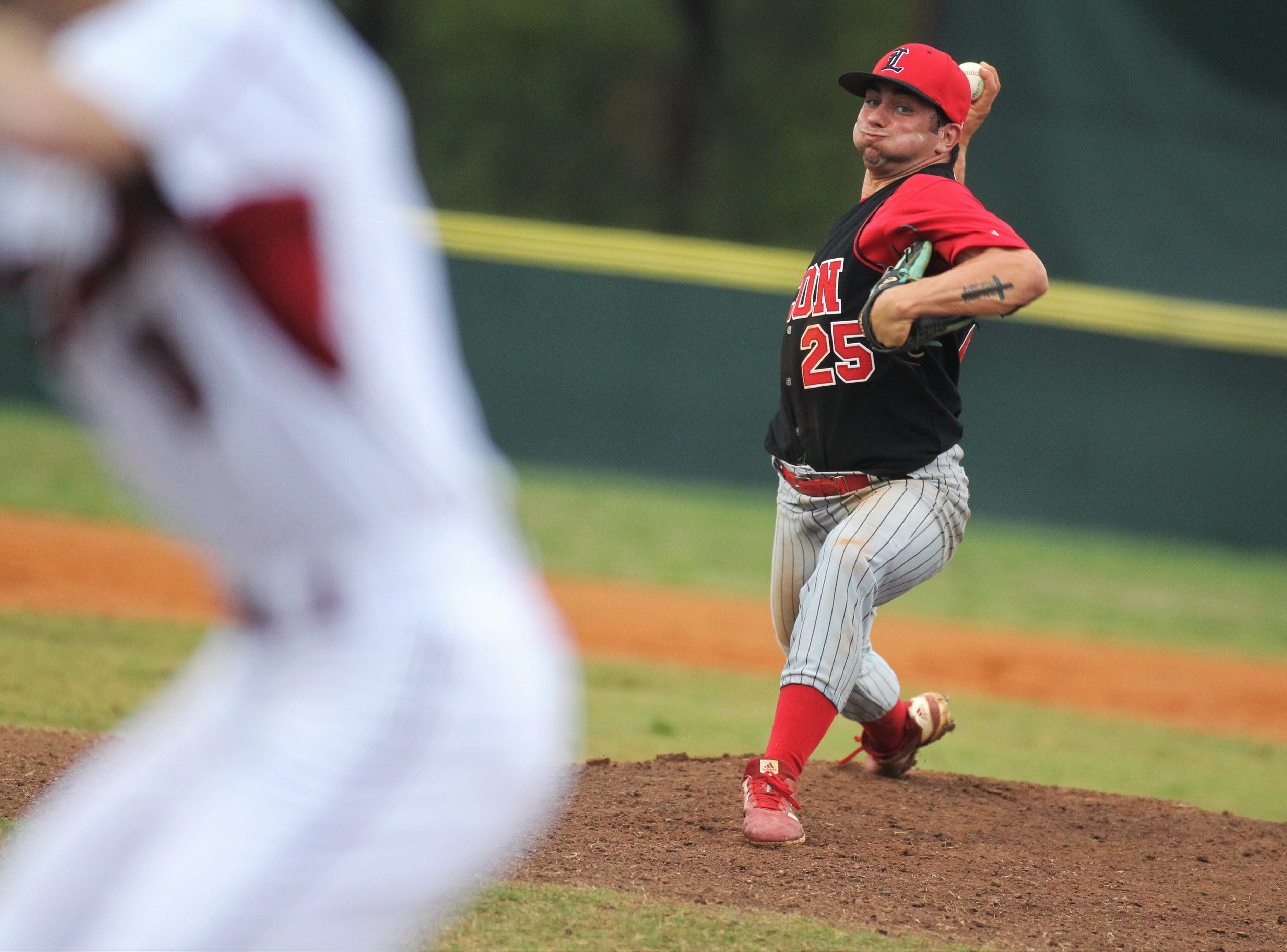Leon senior Tyler Borges pitches as Chiles won an 11-6 home game against Leon on Friday, April 5, 2019, to force a season split. The Lions won 3-0 earlier in the week.
