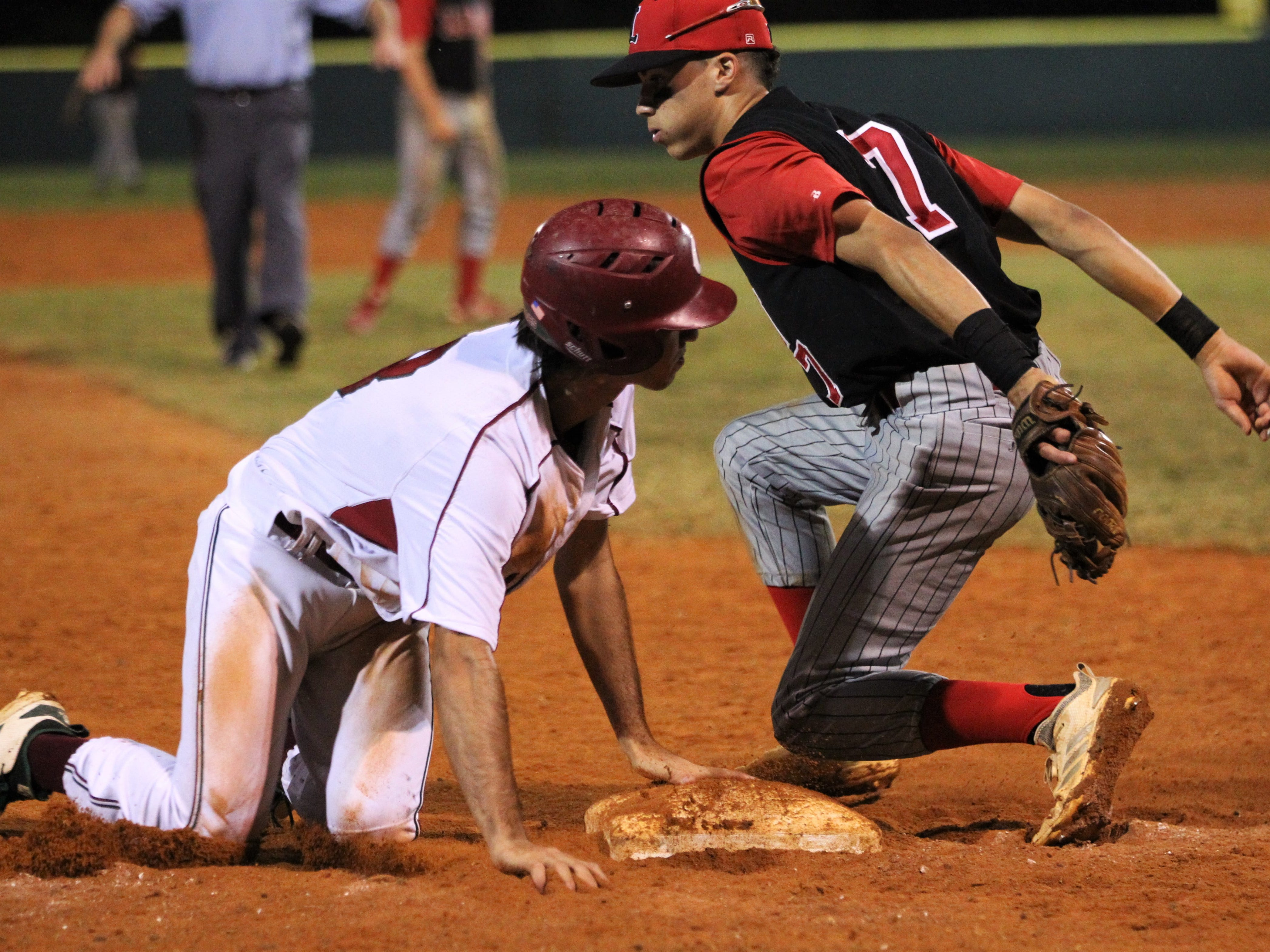 Chiles' Cameron Kelly safely reaches home ahead of a tag by Leon's True Fontenot as Chiles won an 11-6 home game against Leon on Friday, April 5, 2019, to force a season split. The Lions won 3-0 earlier in the week.