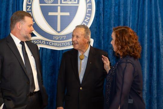 Coach Bowden shares a laugh with headmaster David Pinson.