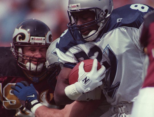 Wide receiver Eric Smith, right, of the Scottish Claymores and Vero Beach, Florida, runs May 25, 1997, while playing against the Rhein Fire in a World League of American Football game in Duesseldorf Rhein-Stadium in Germany. Also shown is the Fire's John Anderson.