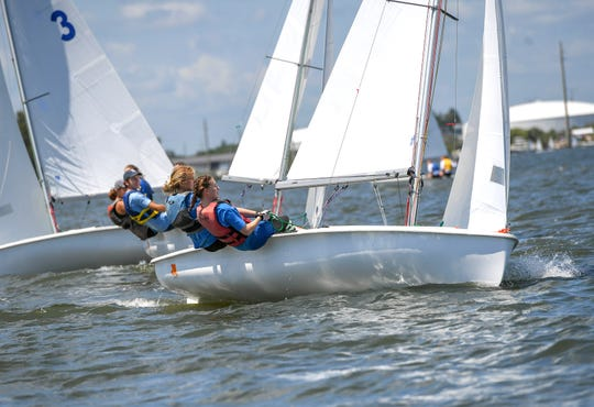 """Mylee Smith, 15 (right), and Kate Bounassi, 14 (second from right), both of Vero Beach, compete against 22 other teams in the 420 class boat race during the Youth Sailing Foundation of Indian River County's Steve Martin Memorial Regatta on Sunday, April 7, 2019, at the southwest corner of the Alma Lee Loy Bridge in Vero Beach. """"I like it because it's kind of relaxing for me. It's a challenge for me, but it's something I want to get good at,"""" Smith said. """"It's a lot of fun, there was good wind, it was kind of intense at some spots, but overall it went well,"""""""