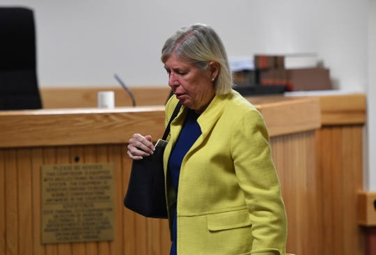 Martin County Commissioner Sarah Heard exits the courtroom for lunch break during jury selection on Monday, April 8, 2019, for her misdemeanor trial at the Martin County Courthouse in Stuart. Commissioner Heard is accused of two first-degree misdemeanor offenses of violating public records laws. The trial under Senior Judge James David Langford is expected to last through the week.