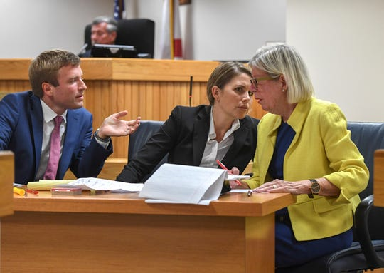 Martin County Commissioner Sarah Heard (right) talks with her attorneys (from left) Jordan Wagner and Barbara Kibbey Wagner, as they prepare for jury selection for Commissioner Heard's misdemeanor trial at the Martin County Courthouse on Monday, April 8, 2019, in Stuart. Commissioner Heard is charged with two first-degree misdemeanor offenses of violating public records laws. The trial under Senior Judge James David Langford is expected to last through the week.