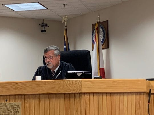 Senior Judge David Langford begins court in the Martin County Commissioner Sarah Heard trial. He's  hearing a couple of  motions before jury selection begins.
