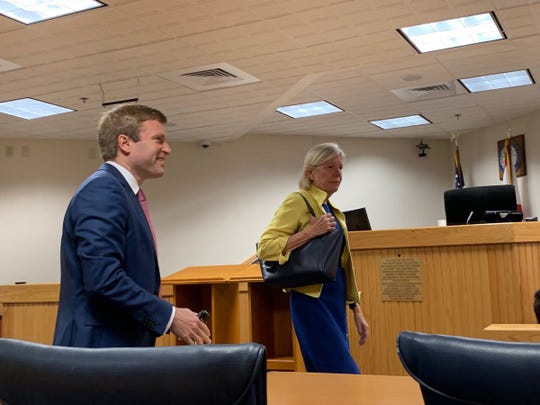 Martin County Commissioner Sarah Heard enters court ahead of her expected weeklong trial.  Her attorney, Jordan Wagner, is on the left.
