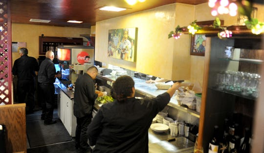 The front counter, where all the food comes out at Ferraro's Italian Restaurant in Ventura is bustling on Saturday night. The restaurant is now on its 49th year.