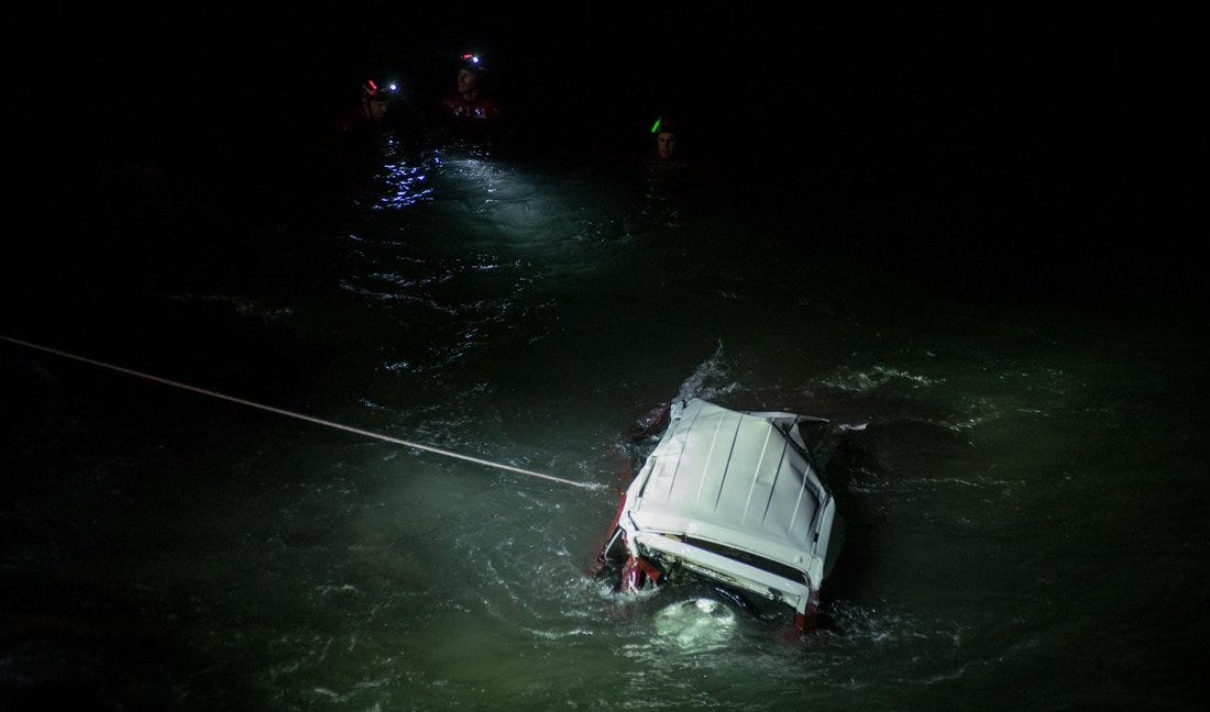 A Toyota FJ cruiser in the ocean off Pacific Coast Highway, south of Mugu Rock, Sunday night. The driver was killed.