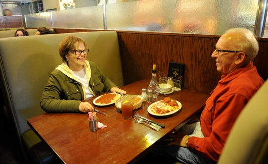 Pat Niederst, left, and her husband Bill Niederst eat at Ferraro's Italian Restaurant in Ventura. Sam Ferraro, who opened the eatery, is gone but members of his family are still running it and have just updated the look of the place.