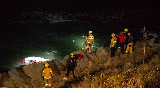 Firefighters respond Sunday night to the scene of a fatal crash on Pacific Coast Highway, south of Mugu Rock.