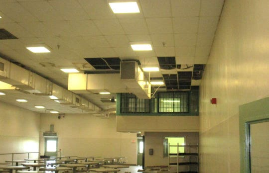 In this undated photo provided by the Prison Law Office, a non-profit public interest law firm that provides free legal services to prison inmates, is a dining hall where damaged ceiling tiles have been removed at the California Substance Abuse Treatment Facility and State Prison in Corcoran, Calif. California is spending $260 million over four years to repair leaking roofs and clear dangerous mold that imperils more than two dozen deteriorating prisons. An inmate lawsuit over the conditions says the repairs aren't moving fast enough.